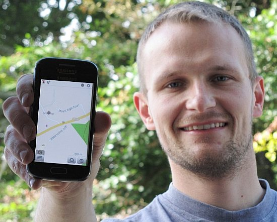 Million Miles Project Officer Peter Elbourne with OpenStreetMap on smartphone